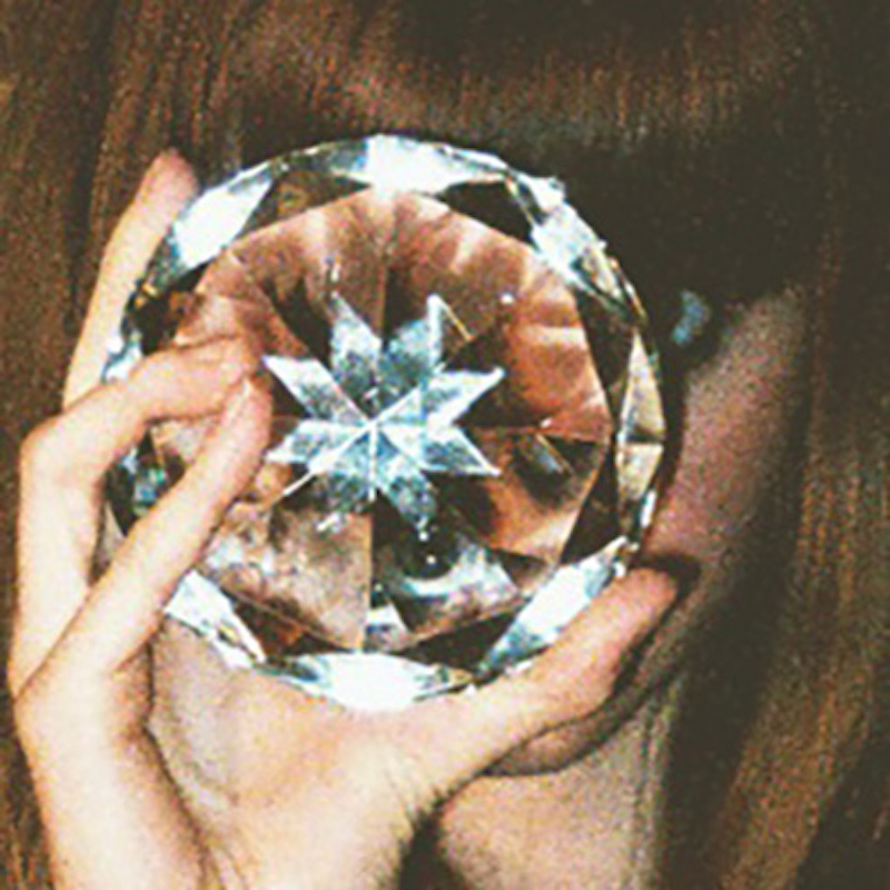 Crystal in front of face