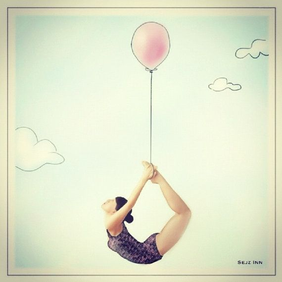 Woman suspended by balloon