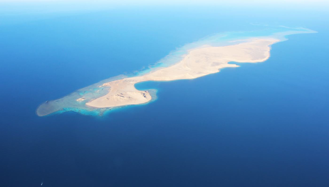 Aerial view of island surrounded by water