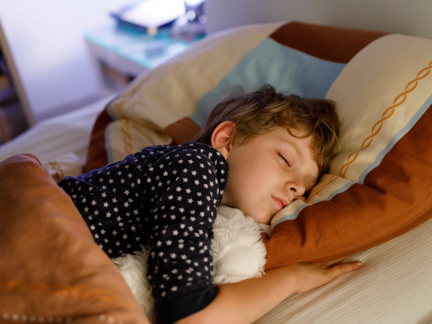 Child sleeping in bed getting good sleep