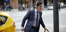 man wearing bose headphones in a city