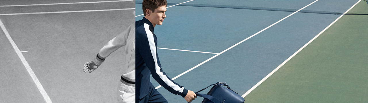 Lacoste man wearing tennis clothing on a tennis court