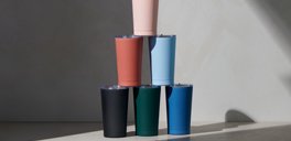 indigo travel tumblers stacked on top of each other