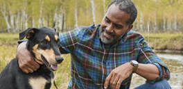 man in ll bean shirt with his dog