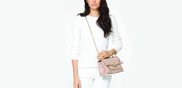 woman standing with cece handbag