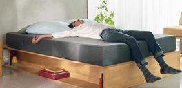 man laying on casper bed