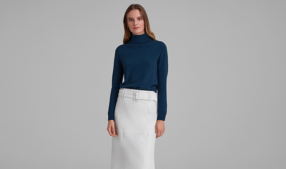 woman in blue sweater and white skirt
