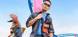 asian asos male model looking down at camera at amusement park