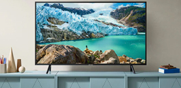 "source.ca samsung 65"" led smart tv on a tv stand"