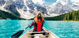 person canoeing on a lake in alberta