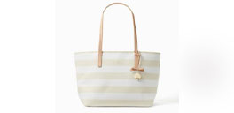 white and beige striped kate spade bag