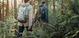 man and woman hiking in the woods