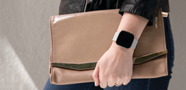 person wearing smartwatch and messenger bag from indigo