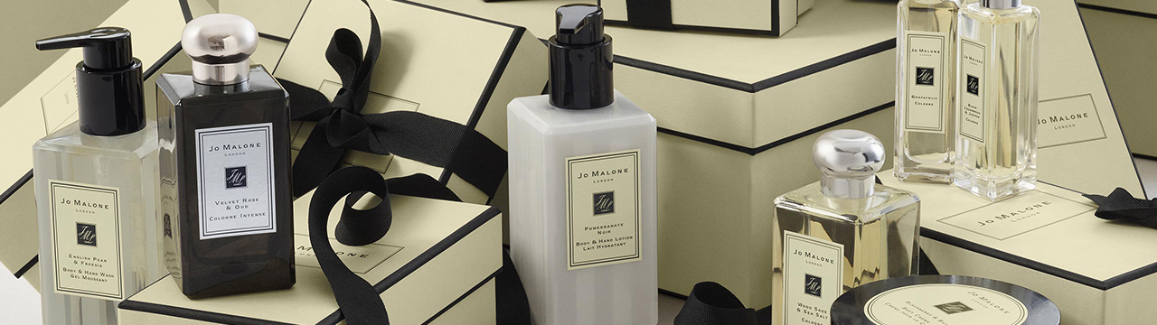jo malone products on display on top of gift boxes