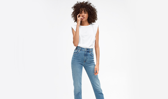 woman wearing jeans and white top