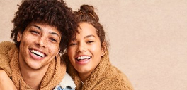 a couple wearing fuzzy clothing smiling