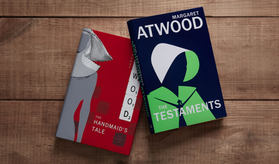 two margaret atwood books on a wooden table