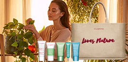 woman with plant and clarins products