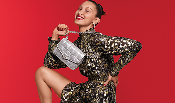 model Bella Hadid, wearing a Michael Kors silver handbag