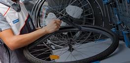 man fixing a bike