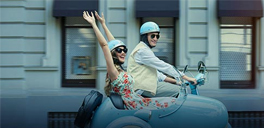 couple riding a double seater vehicle