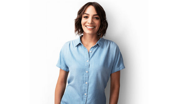 lady smiling looking at the camera and wearing a blue shirt