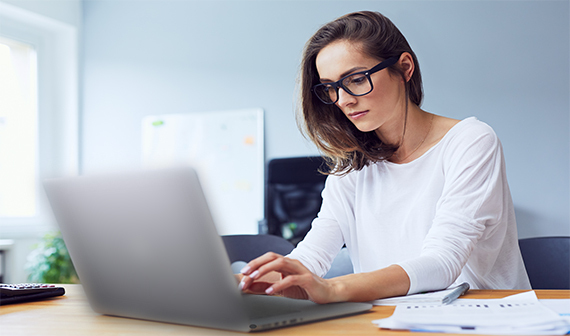 woman working on Dell laptop