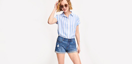 woman in a striped shirt and jean shorts