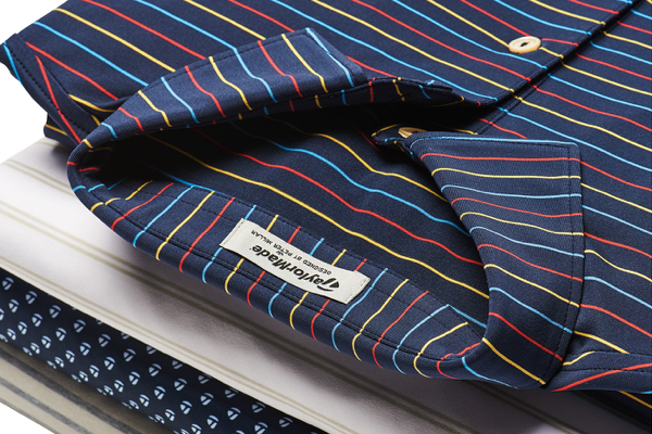 taylor made and peter millar blue golf shirt with red yellow and light blue pin stripes