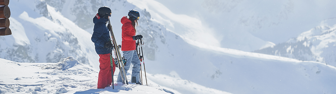 columbia ski athletes standing on edge of mountain