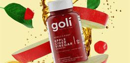 goli apple cider vinegar with fruits behind it
