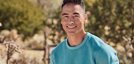 asian male smiling looking at camera wearing clothes from lands end