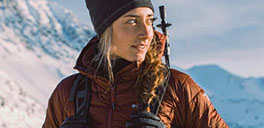 woman looking at snowy montains