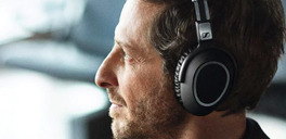 male wearing sennheiser headphones