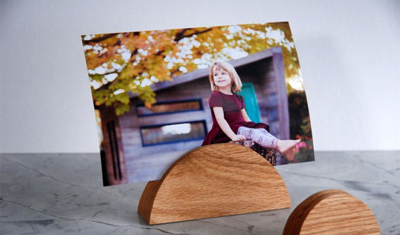picture stand holding a picture of a young girl sitting outside