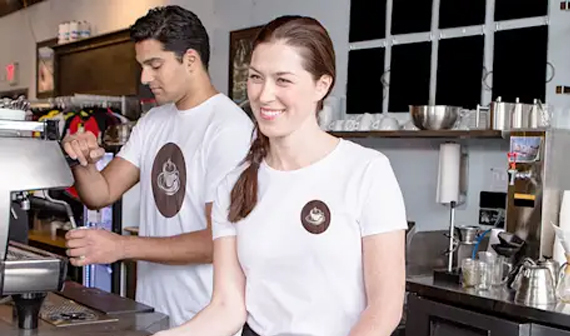 male and female wearing company branded T-shirts