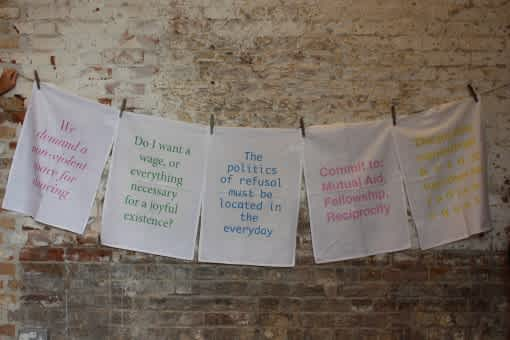 Clothesline with pieces of fabric screen-printed with political messages