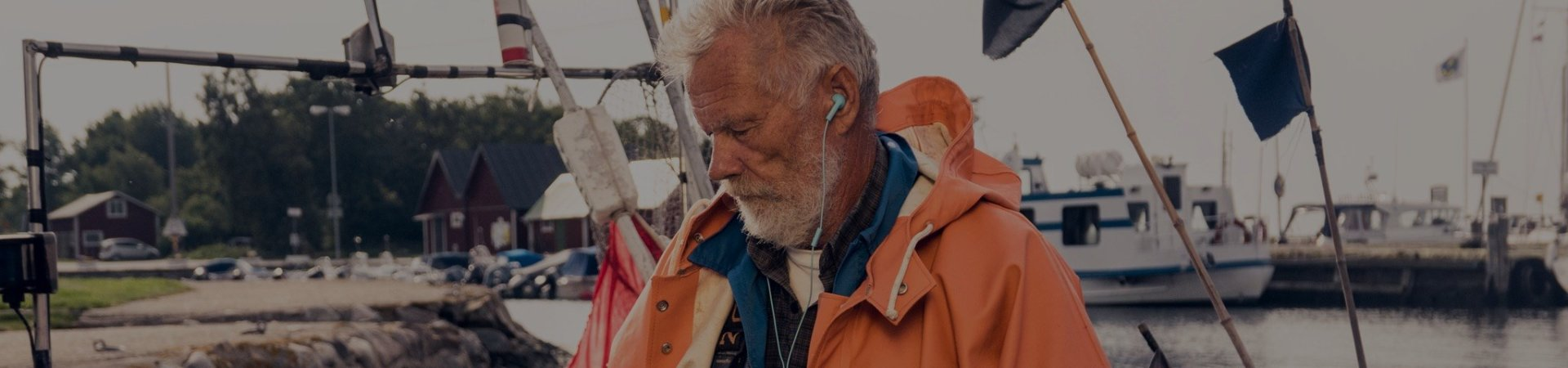 A fisherman listens to an audiobook