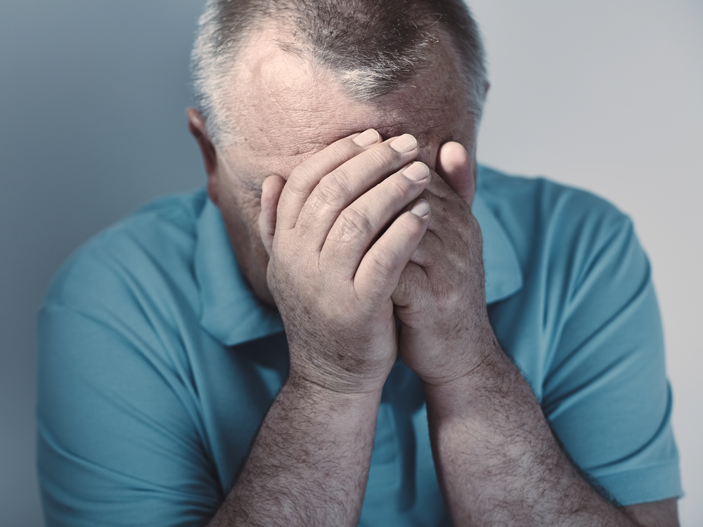 Older man with diabetes showing fear and stress