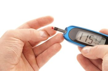 man with diabetes using glucometer glucometer