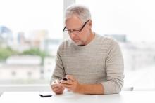 man with prediabetes testing blood glucose levels
