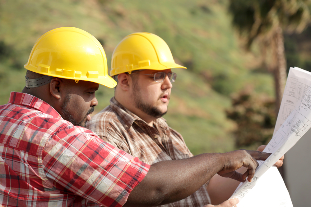 two men with type 2 diabetes working at building site
