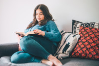 woman with diabetes reading a book prioritising herself