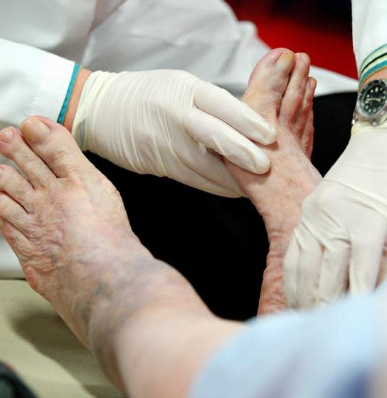 man with type 2 diabetes having a foot exam to check for diabetic neuropathy
