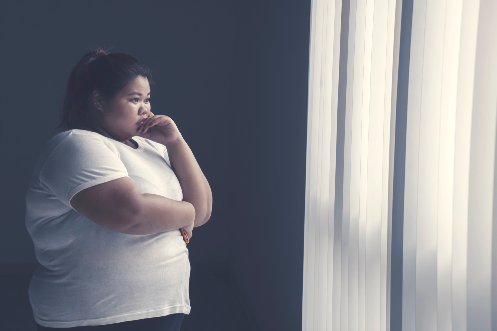 obese woman with type 2 diabetes contemplating