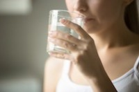 woman drinking water - excessive thirst may be a symptom of type 1 diabetes