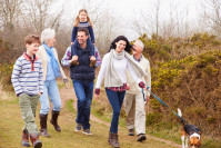 multi-generational family walking
