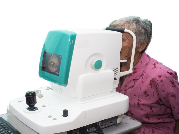 elderly woman with type 2 diabetes having an eye exam to check for diabetic retinopathy