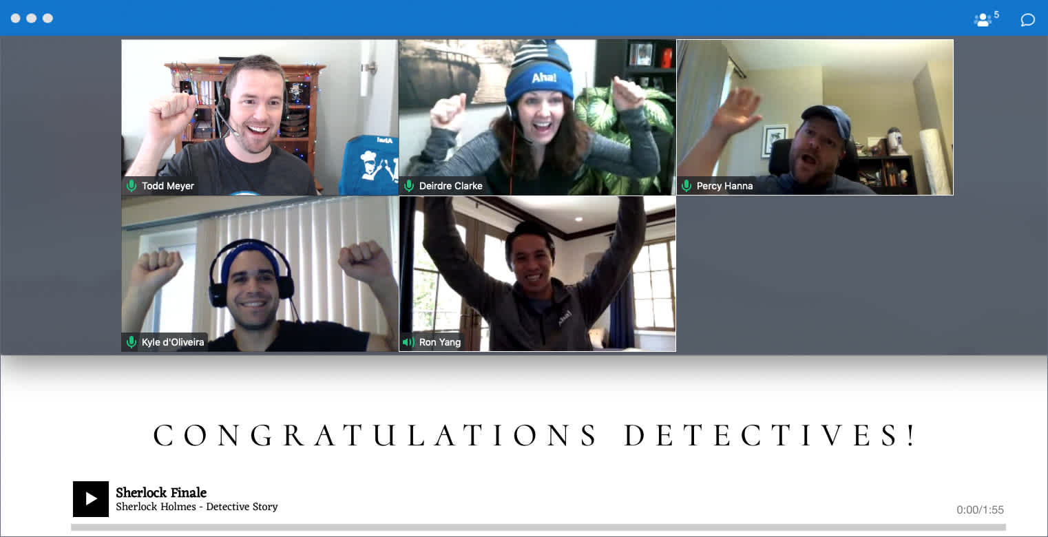 A group of Aha! detectives celebrate cracking the case as part of a virtual game.