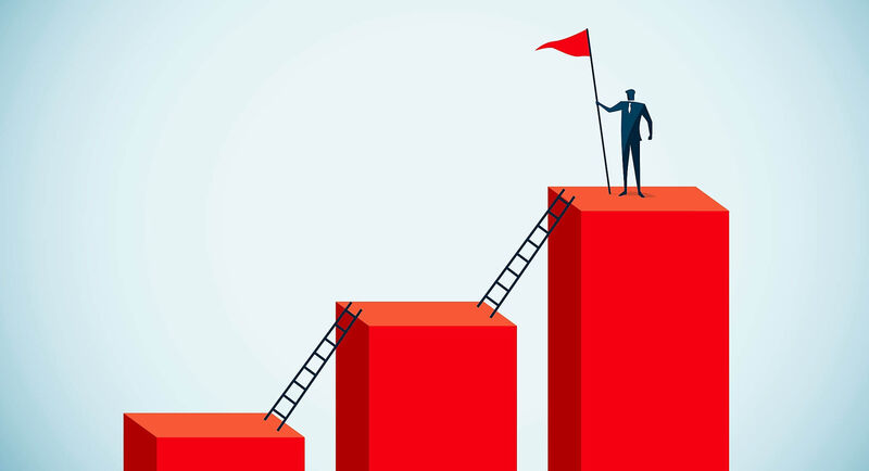 figure holding a flag on the tallest of a series of pillars connected by ladders